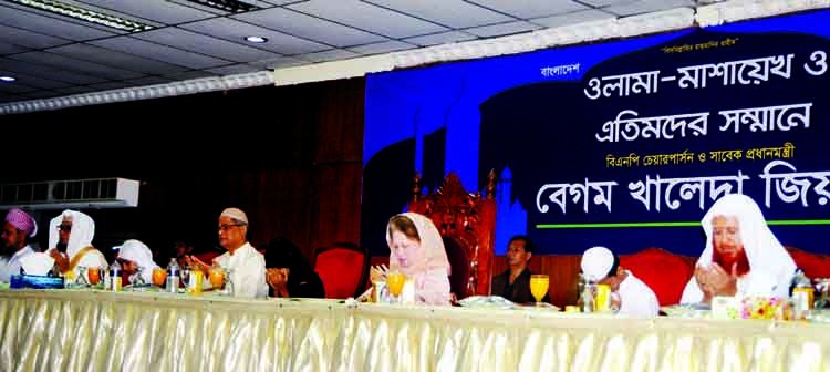 BNP Chairperson Begum Khaleda Zia along with others offering Munajat at an Iftar Mahfil organised for Ulema-Mashaekh and orphans at the Ladies Club in the city on Sunday, the first day of holy Ramzan.