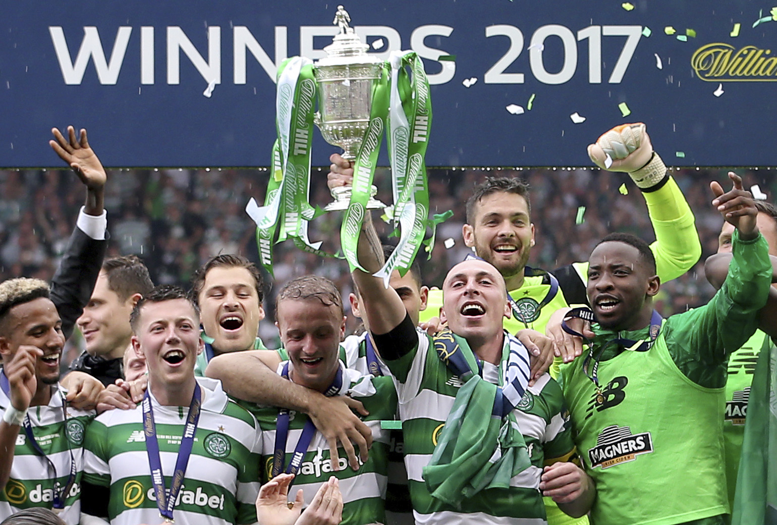 Celtic's players celebrate after winning the Scottish Cup final against Aberdeen at Hampden Park, Glasgow, Scotland on Saturday.