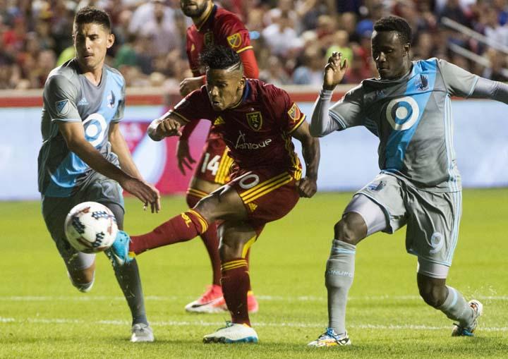 Real Salt Lake forward Joao Plata (10) gets the ball past Minnesota United defender Kevin Venegas (22) and forward Abu Danladi (9) during an MLS soccer match in Sandy, Utah on Saturday.