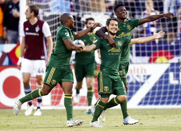 Portland Timbers midfielder Sebastian Blanco (center) celebrates after scoring a goal with midfielder Darlington Nagbe (left) and forward Dairon Asprilla against the Colorado Rapids in the first half of an MLS soccer match on Saturday.