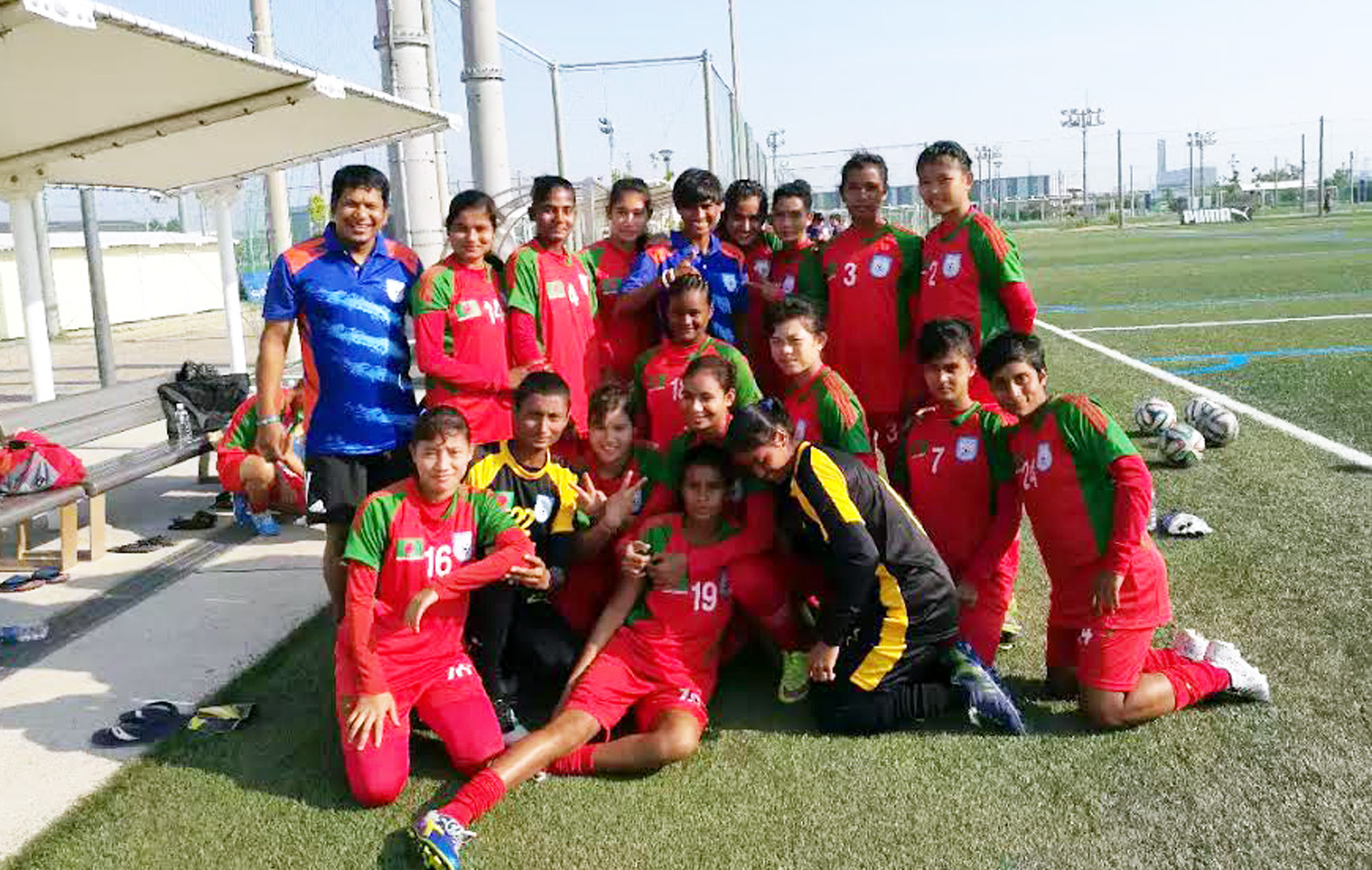 Members of Bangladesh Under-16 National Women's Football team pose for photograph at Osaka city in Japan on Monday.