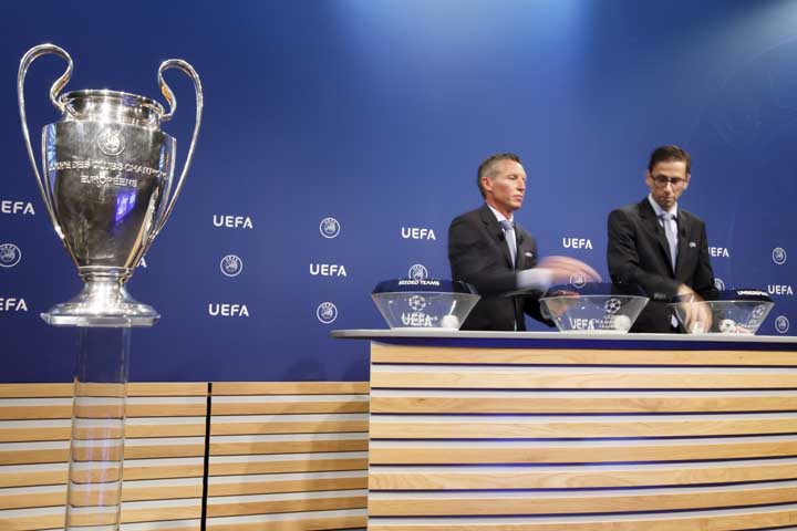 Michael Heselschwerdt, Head of Club Competition and Tobias Hedtstueck (right), Club Competition Regulation remove the balls containing the names of the soccer clubs during the drawing of the games for the Champions League 2017/18 Second qualifying round at the UEFA headquarters in Nyon, Switzerland on Monday.