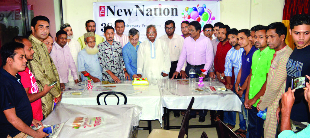 SYLHET:  Invited guests cutting cake  at a function on the occasion of the 38th founding anniversary of The New Nation  organised by  Sylhet Office on Sunday