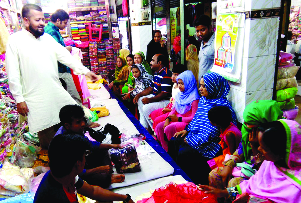 SAPAHAR (Naogaon):  Both buyers and shop keepers are busy  at a market in Sapahar Upazila in Eid shopping  yesterday.