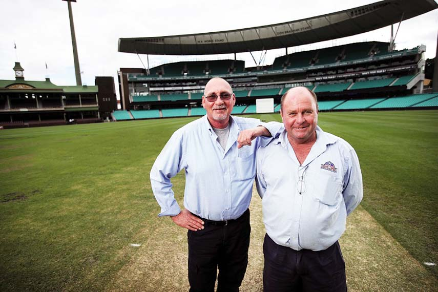 Outgoing SCG curator Tom Parker (left) with Allianz Stadium curator Michael Finch pose for photo in  Sydney on Wednesday.