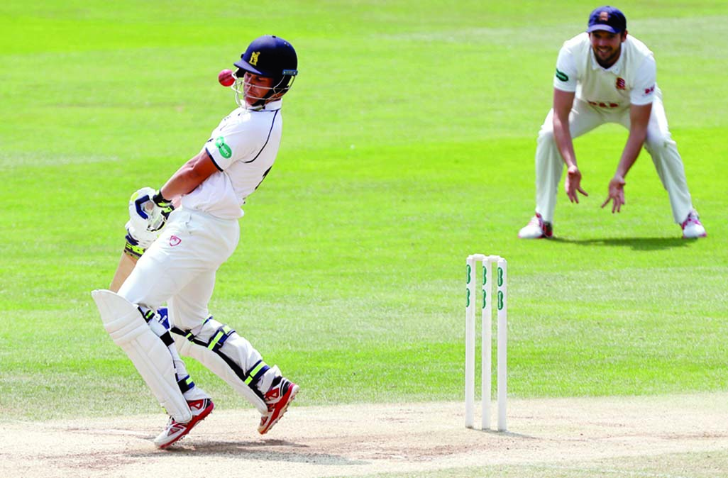 Sam Hain of Warwickshire receives a glancing blow to the helmet during the Essex v Warwickshire - Specsavers County Championship, Division One cricket match at the Cloudfm County Ground in Chelmsford, England on Wednesday.