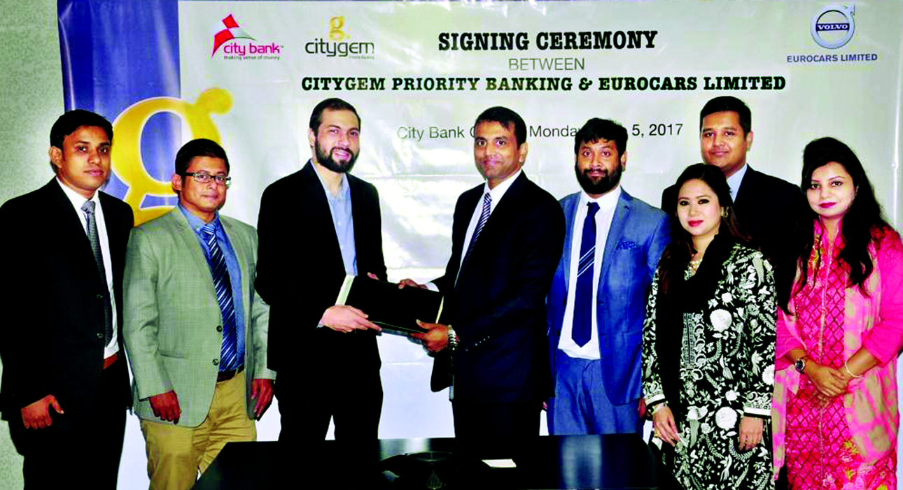 Md Abdul Wadud, DMD of City Bank Ltd. and Yousuf Aman, Director (Operation) of Eurocars Limited, exchanging agreement signing documents at the bank head office in the city recently. Under the deal, members of Citygem, the Priority Banking arm of the bank, will enjoy various exclusive benefits at Eurocars which include a complimentary five years maintenance package, complimentary concierge service, access to priority service lane and many more value adding offers. Nazmul Karim Chowdhury, Head of Brand of the bank and Abu Naser Mahmud, Head of Business Sales of Eurocars Limited and other senior officials from both the organizations were present.