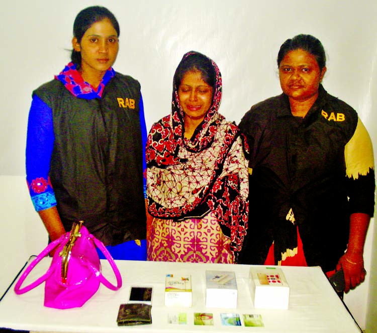 RAB-10 nabbed a young girl namely Laboni Akhtar Nishi along with mobile set and credit card from the city's Demra area on Thursday for her involvement in deceiving people through false love.