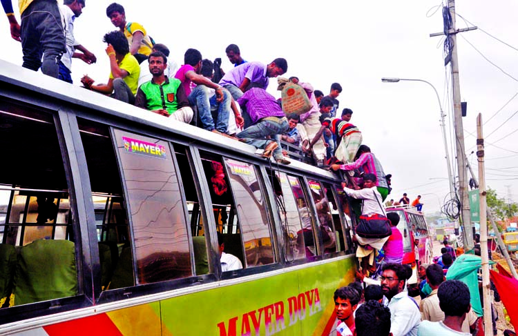 Home-bound passengers going to their respective destination getting on the roof of a bus to celebrate Eid with their near and dear ones. The snap was taken from the city's Gabtoli on Thursday.