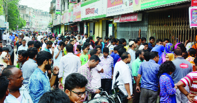 BOGRA: Eid home-goers in long queue to collect bus ticket  at Satmatha Point in Bogra city on Wednesday.