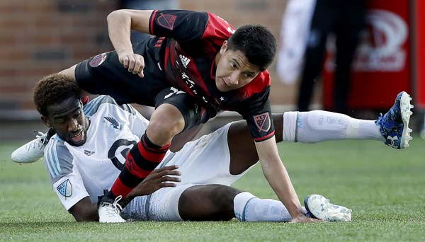 Minnesota United's Kevin Molino (bottom) and Portland Timbers' Marco Farfan (32) get tangled up during the first half of an MLS soccer match in Minneapolis on Wednesday.