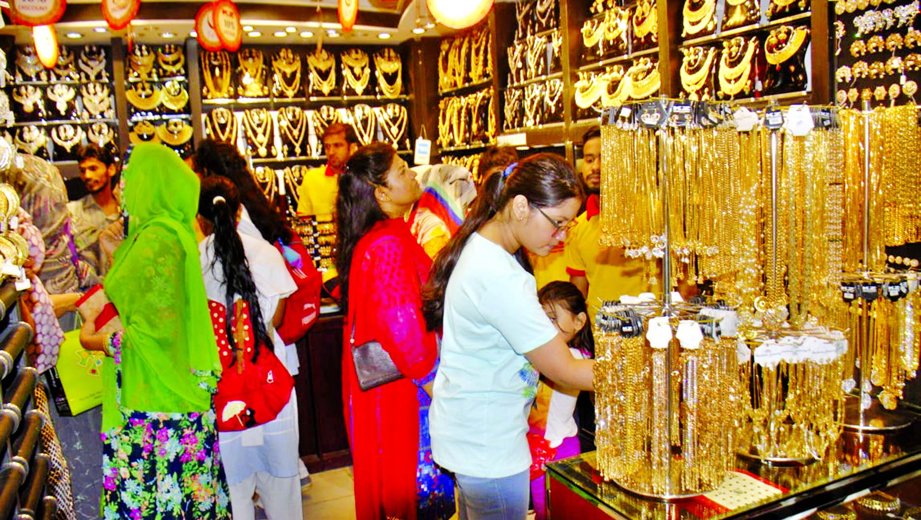 Female shoppers of all ages rush to imitation jewellery shops to make their choice ahead of Eid-ul-Fitr. This photo was taken from Gowsia Market in city on Thursday.