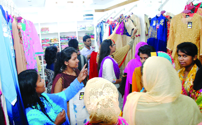 BOGRA: Young girls gathered  at a shop at Rana Plaza on Wednesday.
