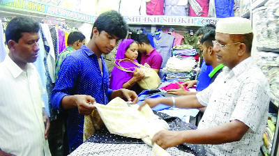 RANGPUR:   Eid shoppers  passing busy time  at Rangpur city markets on Thursday.