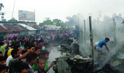 KURIGRAM: At least 20 shops were gutted as a fire broke out at Phulbari upazila Sadar Bazar on Wednesday morning.