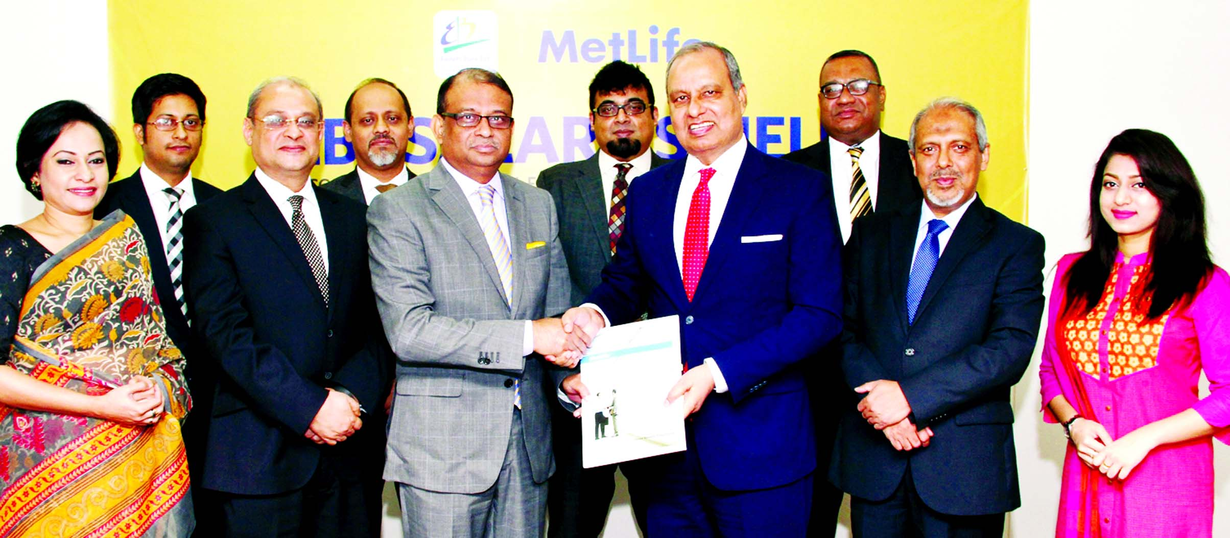 Ali Reza Iftekhar Managing Director of EBL and Md. Nurul Islam, Chairman- Bangladesh, Nepal & Myanmar of Metlife, exchanging documents after signing an agreement titled