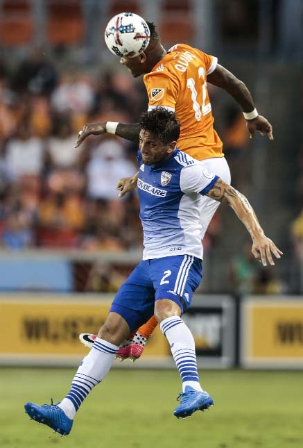 Houston Dynamo forward Romell Quioto (12) and FC Dallas defender Hernan Grana (2) go after the ball during the first half of an MLS soccer game in Houston on Friday.