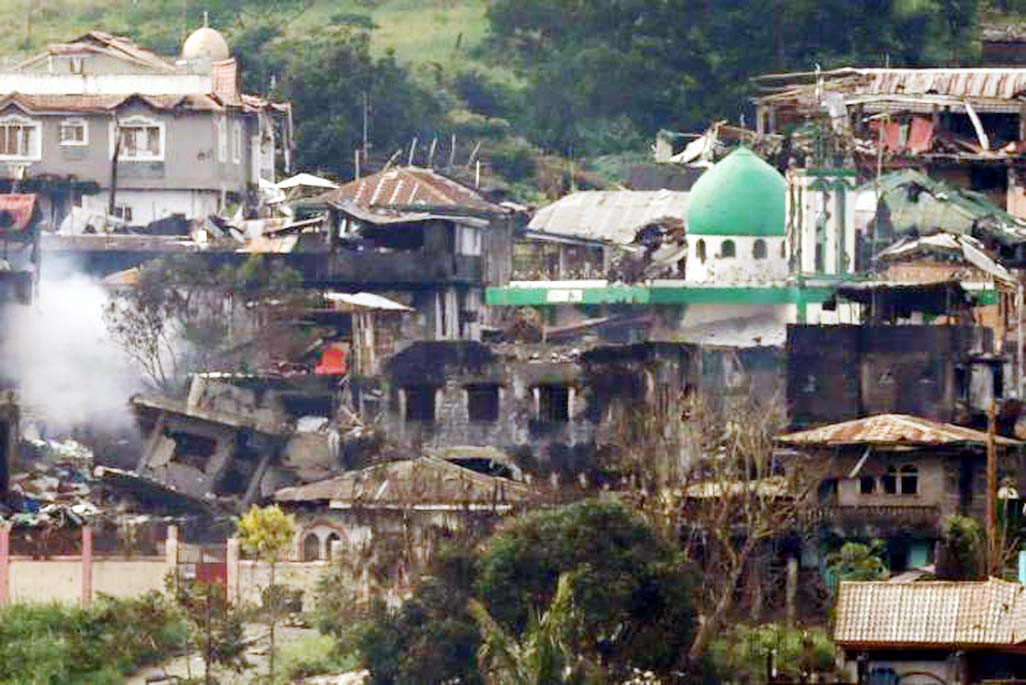 Philippines says bodies of beheaded civilians found in rebel-held town
