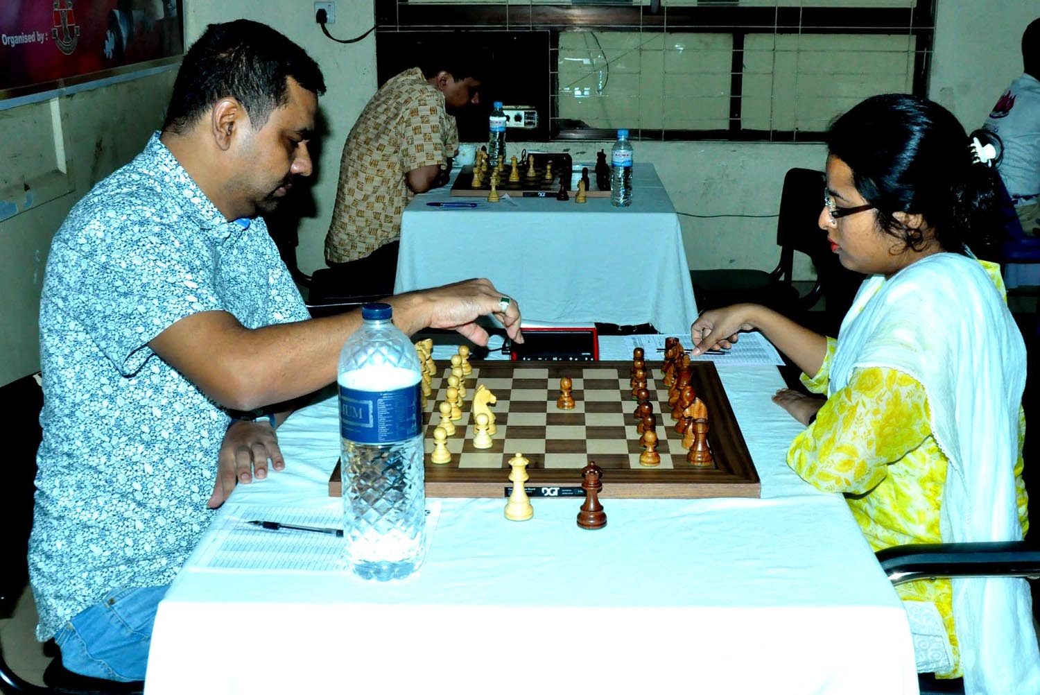 Grand Master Ziaur Rahman Zia (left) moves a pawn against his opponent during the match of the Saif Powertec International Rating Tournament at Bangladesh Chess Federation hall-room on Sunday.