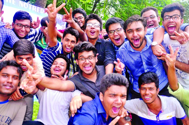 Students of the city's Notre Dame College rejoicing on the campus on Sunday as they made good result in the HSC examination.