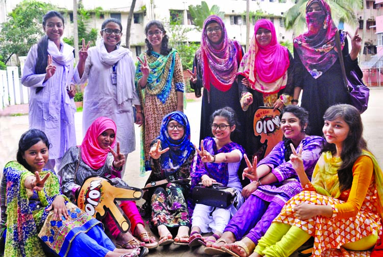 Students of the city`s Motijheel Ideal School and College showing victory (V) sign on its campus on Sunday for their brilliant results in the HSC examination.