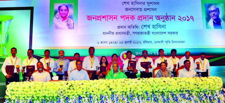 Prime Minister Sheikh Hasina poses for photograph with the recipients of Public Administration Medal at Osmani Memorial Auditorium in the city on Sunday.