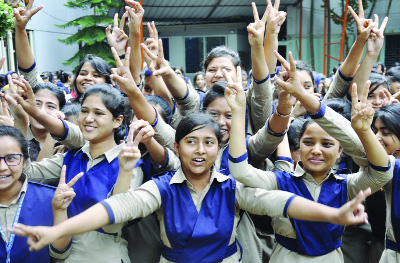 DINAJPUR: Students of  Dinajpur Holyland College rejoicing  HSC result as the college achieved cent percent pass  yesterday.
