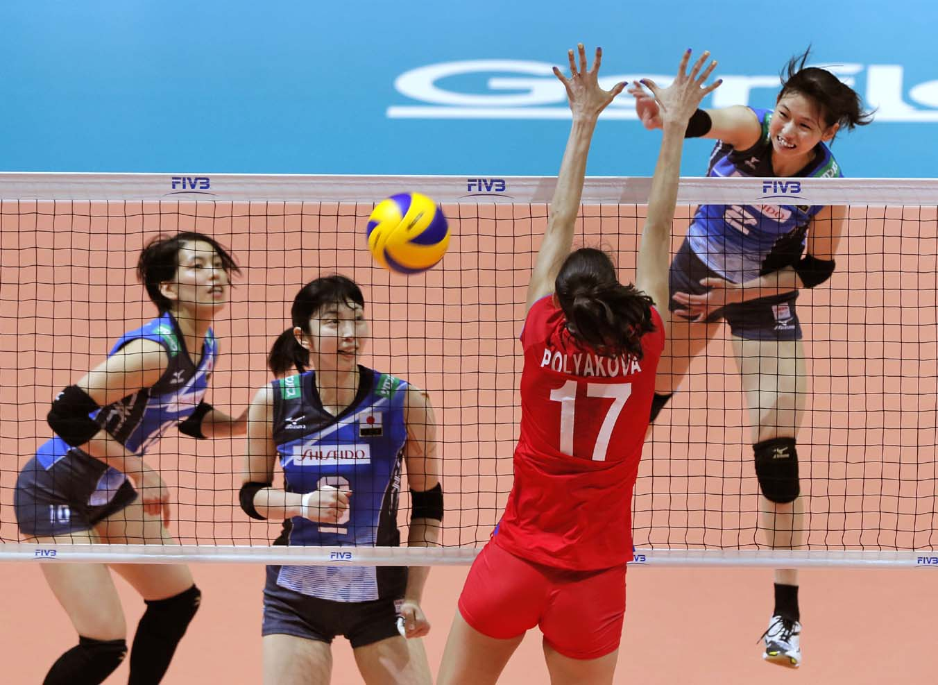 Japan's Sarina Koga (right) (2) spikes the ball during the match against Russia in the World Grand Prix volleyball women's championship in Hong Kong on  Sunday.