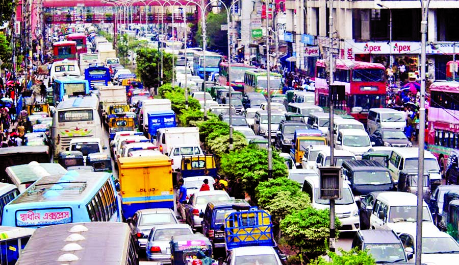 Thousands of vehicles remained stuck in traffic gridlock, causing sufferings to commuters for several hours. This photo was taken from Farmgate area on Monday.