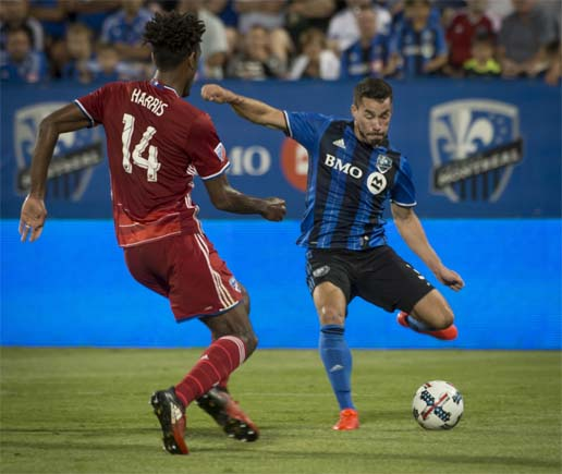 Montreal Impact's Blerim Dzemaili (right) gets set to shoot on the goal as FC Dallas' Atiba Harris defends during second-half MLS soccer game action in Montreal on Saturday.