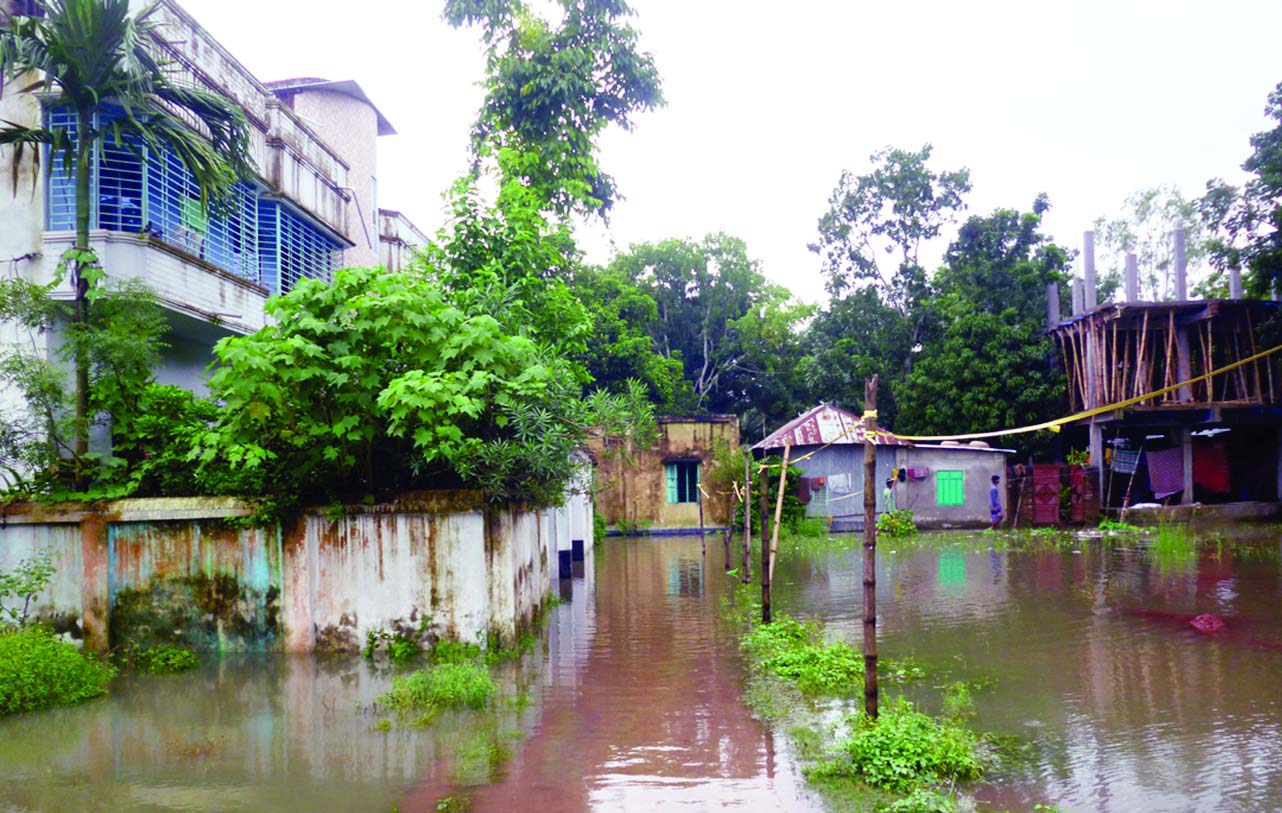 FARIDPUR:  Major areas in Faridpur have been submerged due to rainfall for two days. This snap was taken from  Roghunandonpur area on Tuesday.