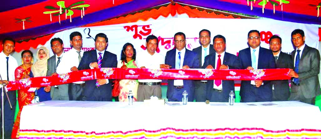 Masihul Huq Chowdhury, AMD of Midland Bank Limited, inaugurating its Agent Banking Booth at Palora Bazar, Batila Thana in  Manikganj on Monday. Clients, businessmen and local elites were present.