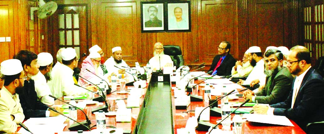 Sheikh Moulana Mohammad Qutubuddin, Chairman, Shariah Supervisory Committee of Islami Bank Bangladesh Limited, presiding over it's a meeting at the banks head office in the city on Monday. Dr. Mohammad Abdus Samad, Member Secretary of the Committee and Md Mahbubul Alam, Additional Managing Director of the bank were present.