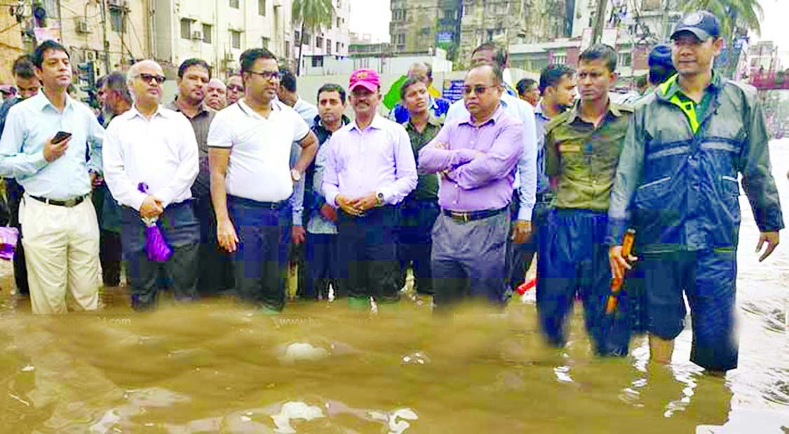 Local elite of Dhanmandi area  protest waterlogging by standing in knee deep water on the road in front of Rapa Plaza  yesterday.