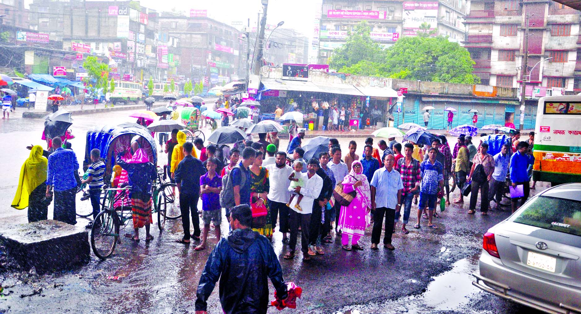 Home-going passengers waiting for several hours due to lack of transports as waterlogging created all over the capital. This photo was taken from Jatrabari area on Wednesday.