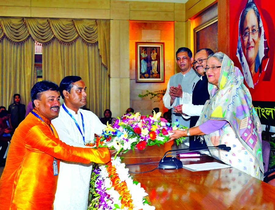 President and General Secretary of Bangladesh Awami Swechchhasebok League, Dhaka Mahanagar Dakshin greeting Prime Minister Sheikh Hasina by presenting bouquet at Ganobhaban on Thursday marking 23rd founding anniversary of the organisation.