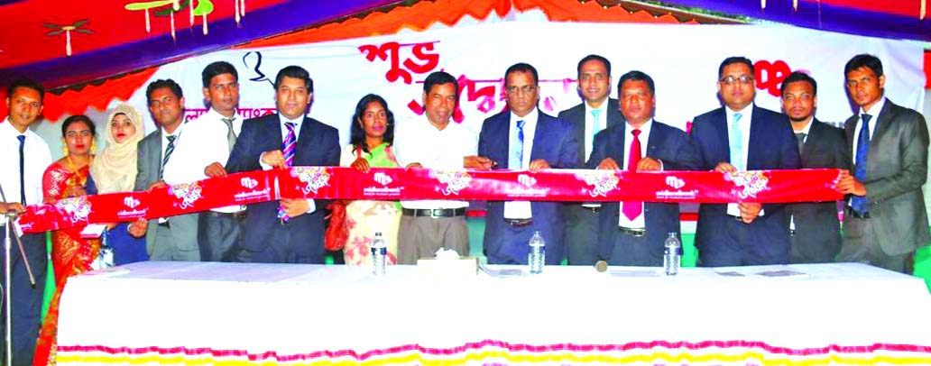 Masihul Huq Chowdhury, AMD of Midland Bank Limited, inaugurating its Agent Banking Booth at Palora Bazar, Batila Thana in  Manikganj on Monday. Clients, businessmen and local elite were present.
