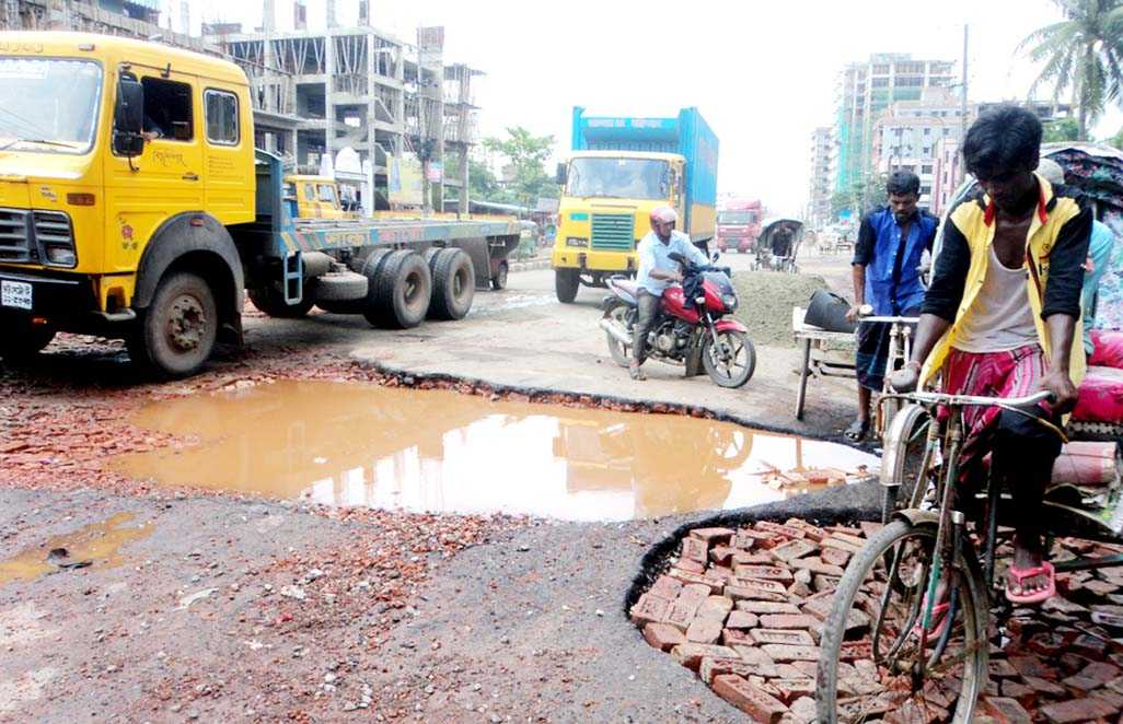 Dilapidated Nimtoli- Alankar Road in Chittagong City  has been badly damaged due to continuous rainfall  for two days  which needs immediate repair. This snap was taken yesterday.