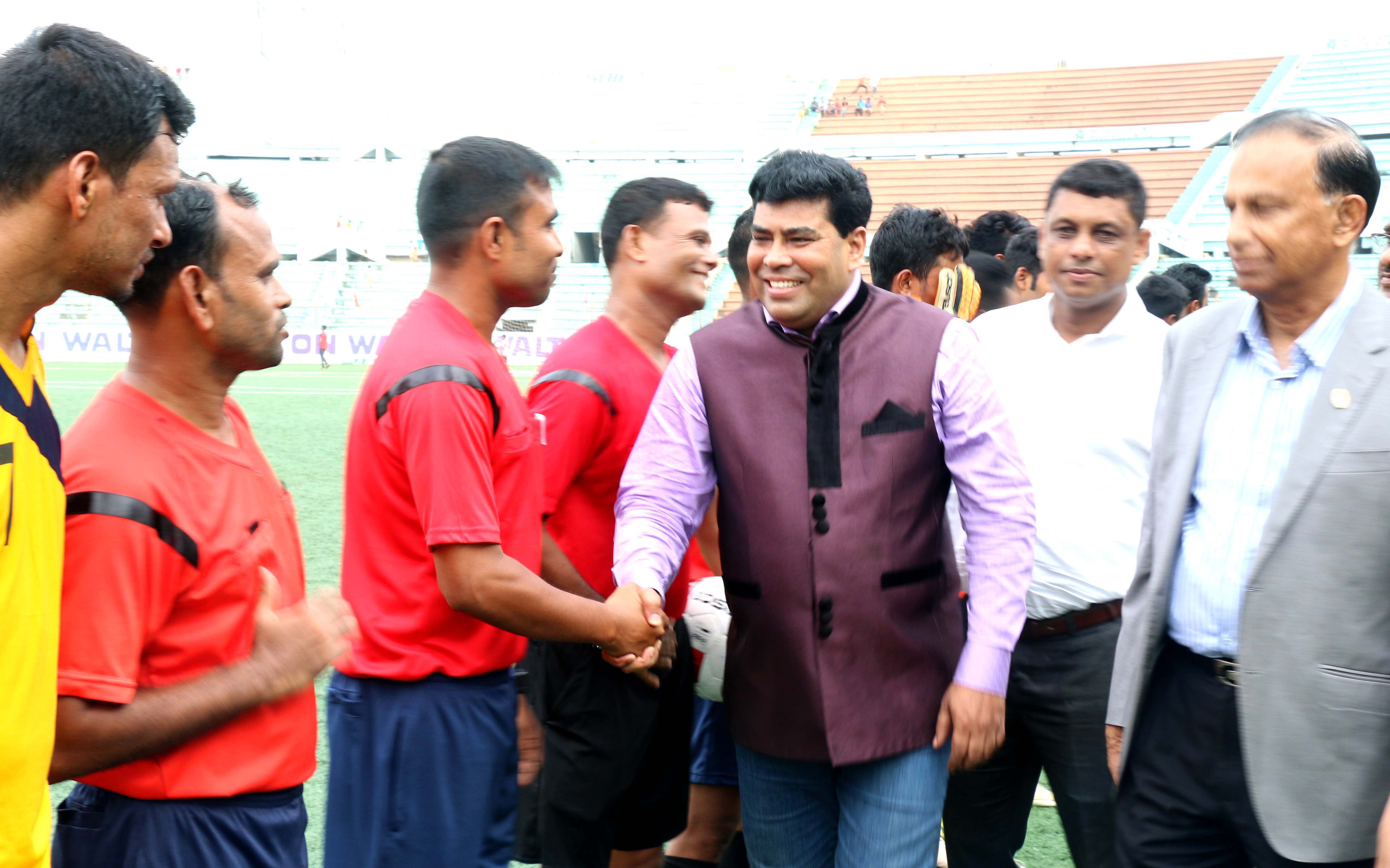 Operative Director (Head of Sports & Welfare Department) of Walton Group FM Iqbal Bin Anwar Dawn being introduced with the players of the participating teams of the Walton 1st Dhaka Metropolis Football Tournament as the chief guest at the Bir Shreshtha Shaheed Sepoy Mohammad Mostafa Kamal Stadium in the city's Kamalapur on Thursday.
