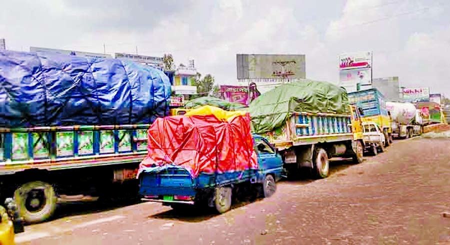 About 40 km tailback with hundreds of heavy vehicles including goods laden trucks got stuck for several hours on the western side of Bangabandhu Bridge, due to appalling situation of road. This photo was taken on Thursday.