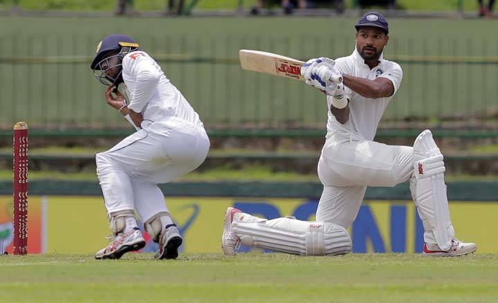 Spinners put India on backfoot after Dhawan ton