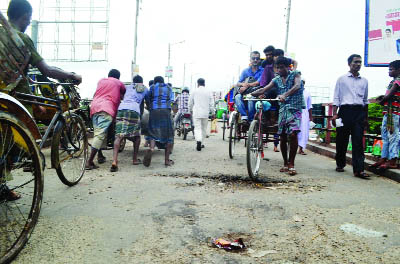 SYLHET:   Vehicles  and people are facing difficulty as crack have  been developed on King-bridge Road. This snap was taken yesterday.