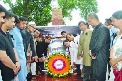 TANGAIL:  Teachers of Mawlana Bhashani Science and Technology University placing wreaths on the portrait of Bangabandhu Sheikh Mujibur Rahman on the campus yesterday.