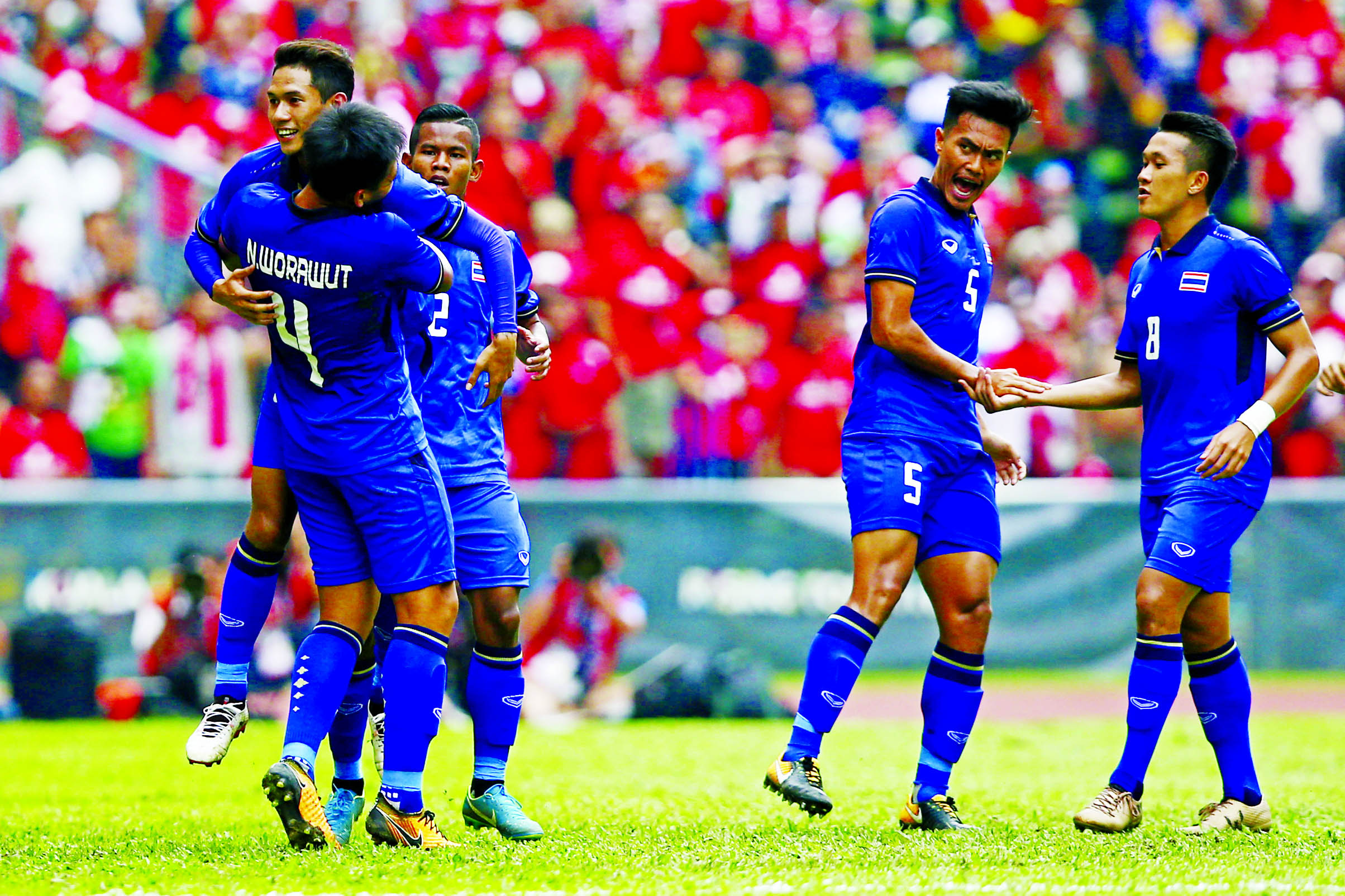 Thailand`s Chaiyawat Buran (left) celebrates after scoring a goal against Indonesia during the soccer match at the South East Asian Games in Shah Alam, Malaysia on Tuesday.