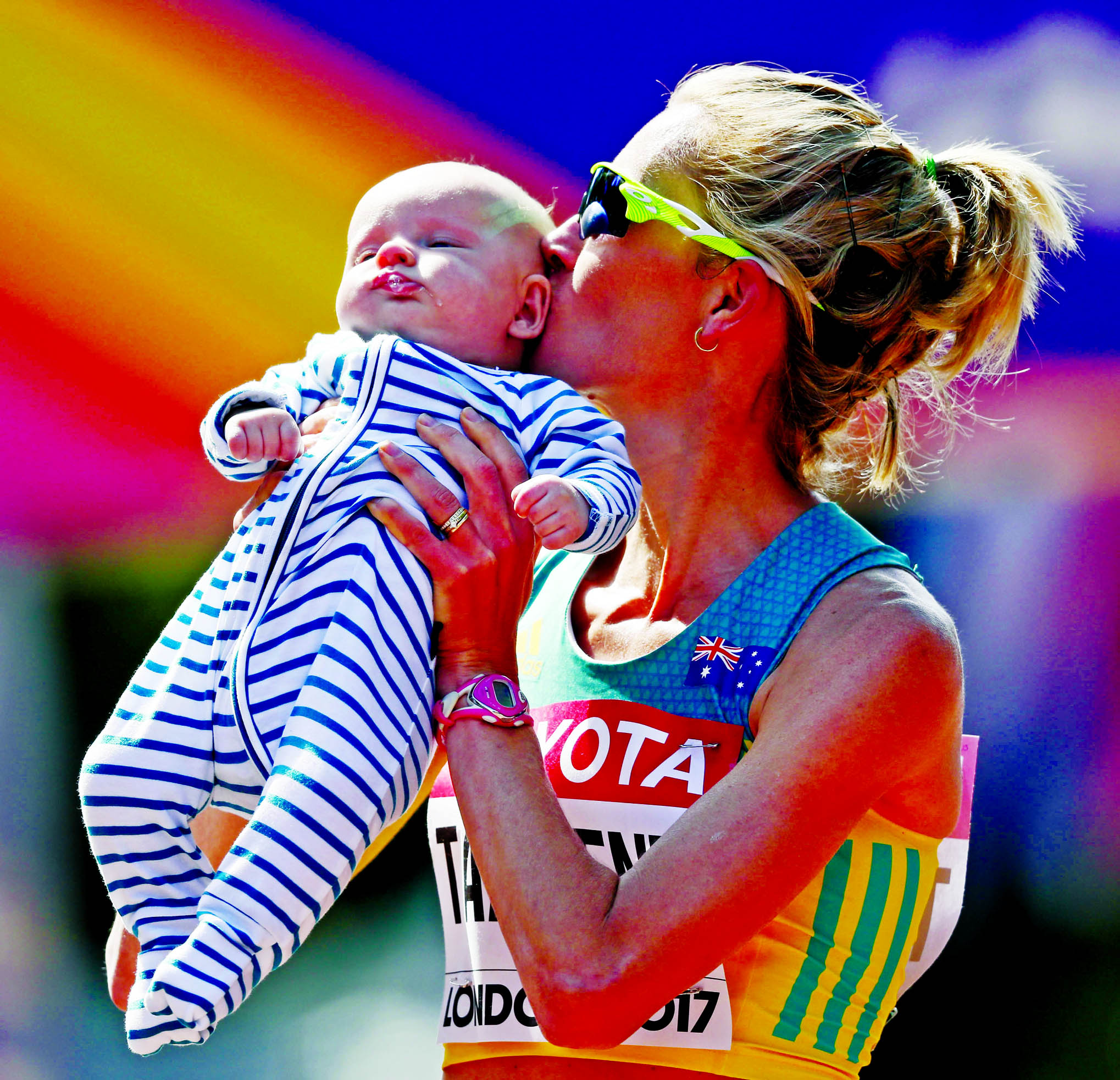 Australia`s Claire Tallent kisses her 12-weeks-old son Harvey after finishing the women's 20-kilometer race walk during the World Athletics Championships in London on Sunday.