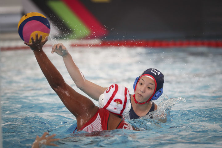 Thailand's Rojnaree Taweechai (right) battles for control the ball with Indonesia's Ivy Nernie Priscilla at the women's water polo round robin during South East Asian Games in Kuala Lumpur, Malaysia on Wednesday.