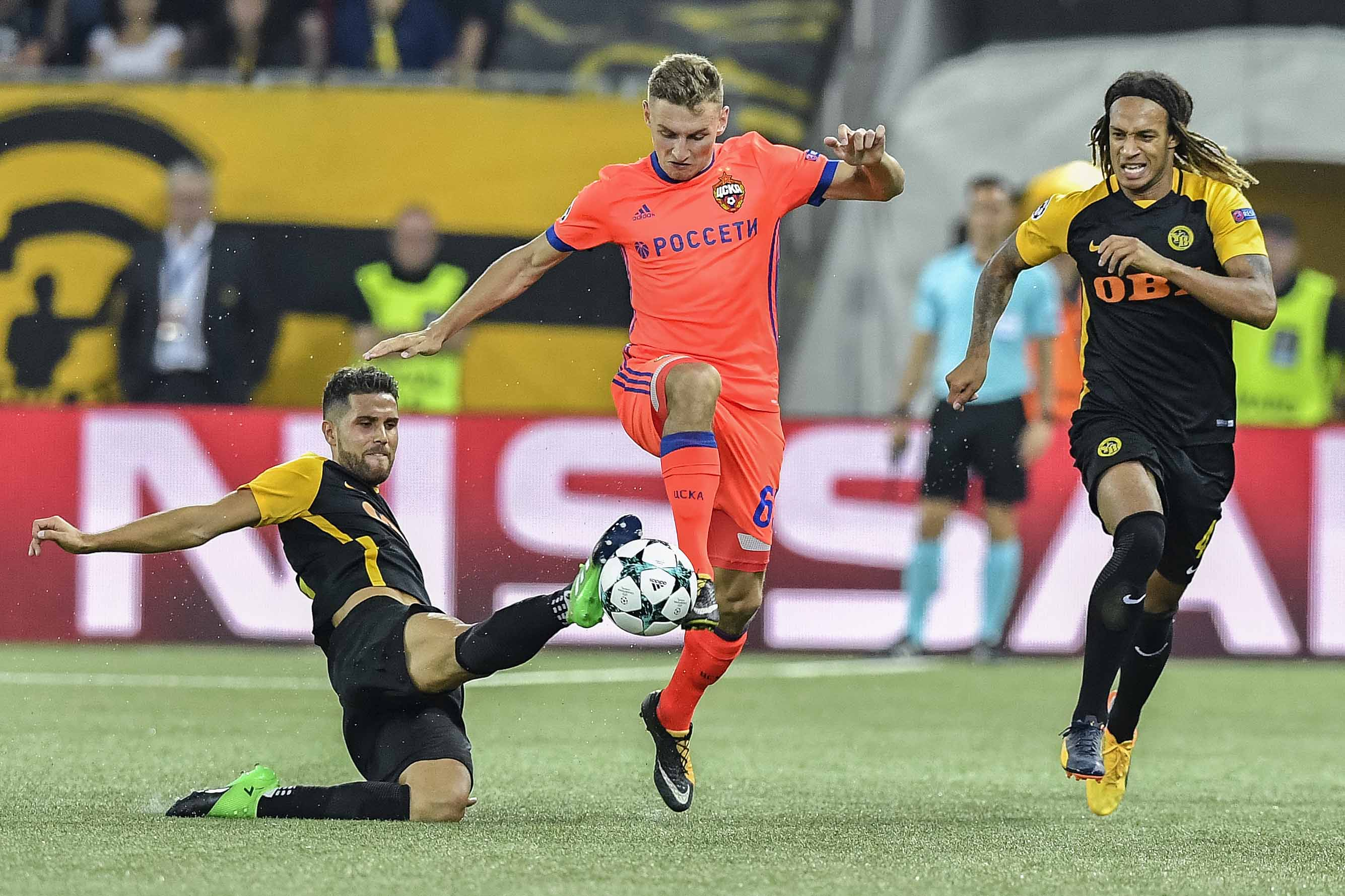 Bern's Leonardo Bertone (left) and Kevin Mbabu (right) challenge for the ball against Moscov's Fedor Chalov during a Champions League's qualifier first leg soccer match between BSC Young Boys and CSKA Moscov, in the Stade de Suisse Stadium in Bern, Switzerland on Tuesday