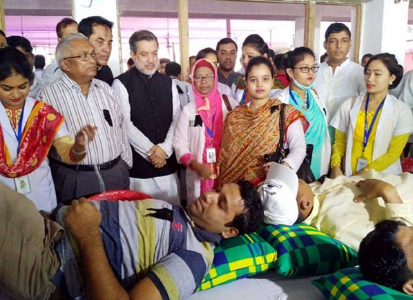 Chairman of the Parliamentary Standing Committee on Ministry of Railway ABM Fazle Karim Chowdhury MP visiting the voluntary blood donation program  at Raozan marking the National Mourning Day  arranged at upazila square as Chief Guest on Tuesday.