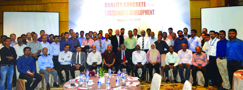 Rajesh Surana, CEO of LafargeHolcim Bangladesh, poses with the participants of a technical seminar on 'Quality Concrete for Sustainable Development' at a city hotel on Wednesday. Petr Dobry, Technical Expert of Cement Industrial Performance, LafargeHolcim, Singapore, Dr. M Shamim Z Bosunia, Managing Director of Adobe Consultant Pvt. Limited and high officials of the company were also present.