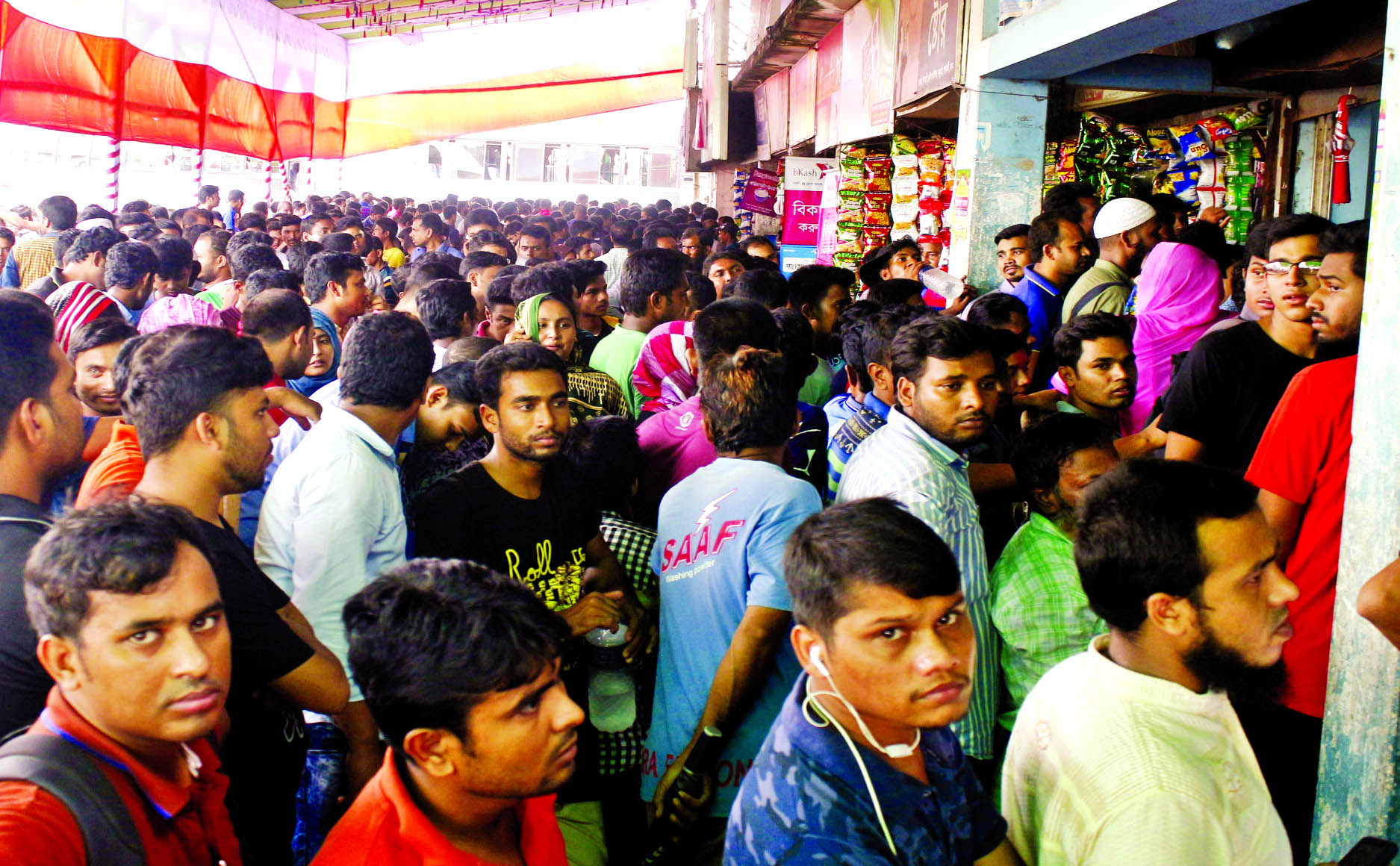 Thousands of people thronged the Gabtali bus terminal counter to buy Eid-ul-Azha advance tickets started to sale yesterday.